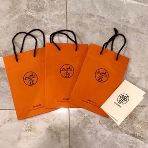 Three (3) Hermès Shopping Bags and Receipt Holder